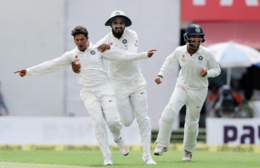 Kuldeep shines on debut as India bundle out Aussies at 300 despite their strong start