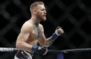 Conor McGregor will not retire after fight with Floyd Mayweather, says Coach