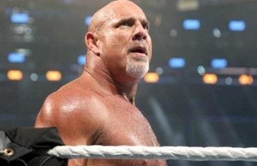 Goldberg says good bye to the  WWE fans after his loss to Brock Lesnar