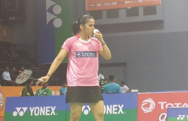 Defending champion Srikanth crashes out while Saina enters RD 2 of India SS