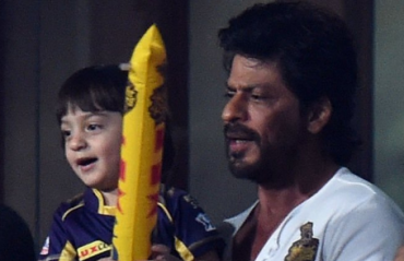 KKR co-owner SRK enjoys the game with son AbRam at Eden Gardens