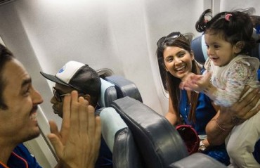WATCH: How Harbhajan Singh's adorable daughter gets glued to Mitchell Johnson on flight