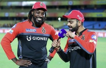 Virat Kohli donates one of his prized possessions to Chris Gayle Foundation