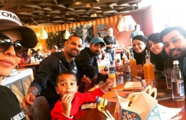 Indian openers enjoy a meal with their families en route to London