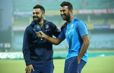 Inspired by Pujara's ability to bat for long periods, says Kohli