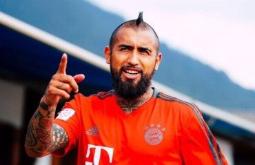 Barcelona sign Chilean international Arturo Vidal from Bayern Munich