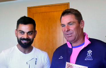 Virat Kohli receives the Sportstar's Sportsman of the Year award by Royals Brand Ambassador Shane Warne