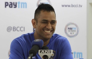 Dhoni takes time off to meet special children at charity event