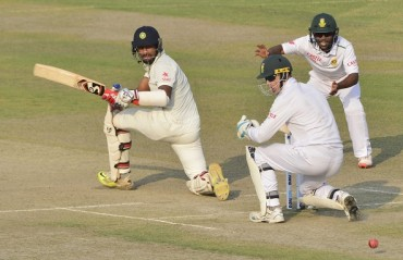 TEST -- Day 2: SA succumb to spin; Ashwin fifer, Pujara 50 keeps India ahead