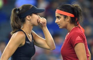 Defending champs SanTina exit Wimbledon after quarter-final loss